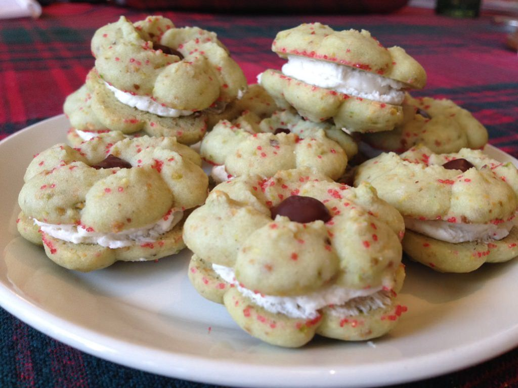 Pistachio Spritz Cookies with Vanilla Cream Filling | Grabbing the Gusto