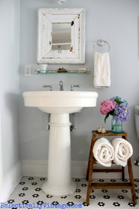 small bathroom storage between pedestal sink and toilet