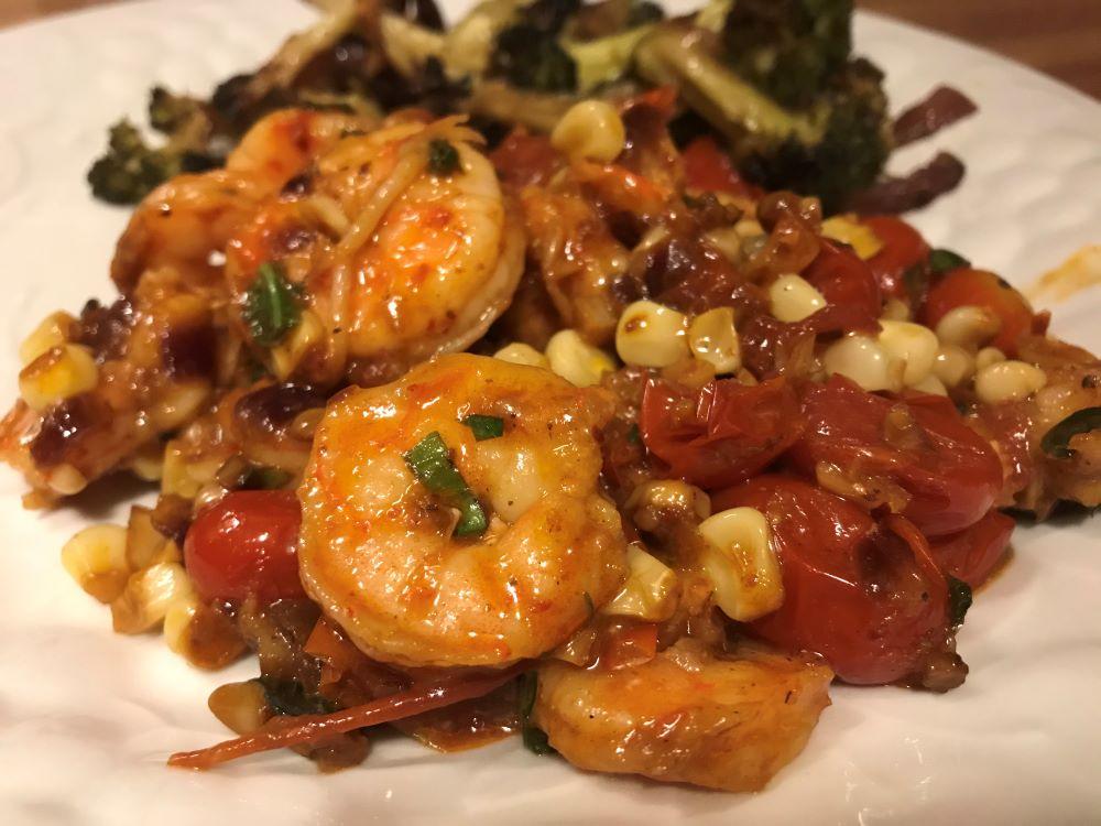 Menu ideas and recipes for shrimp, spice/herb mixes, pork, peaches, peppers, chouriço and vegetables
